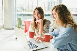 Happy Girls vs Laptop in Cafe