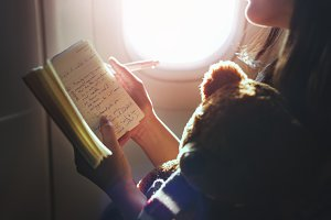 Woman Reading Book Plane Flying