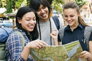 Friends checking the map