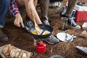 Campers making breakfast