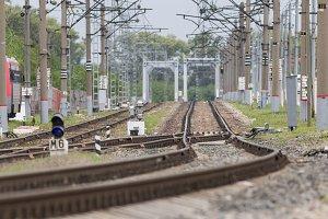 Railway tracks and bridge on crushed stone, telephoto