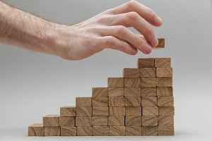Male hand with wooden blocks