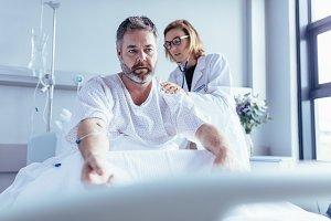 Doctor examining mature man