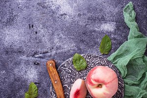 Fresh ripe peaches on concrete background