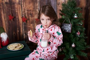 Girl with Christmas Cookies and Milk