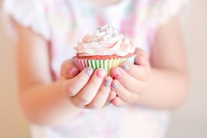 Little Girl Holding Birthday Cupcake