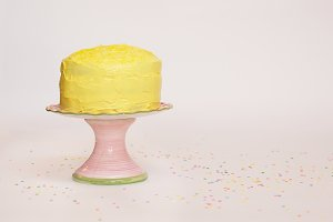 Yellow Cake on Pink Stand