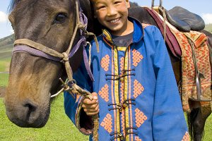 Little boy with his horse