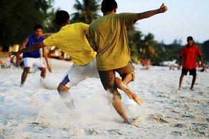 Soccer on tropical beach