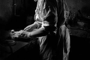 Malaysian lady preparing food