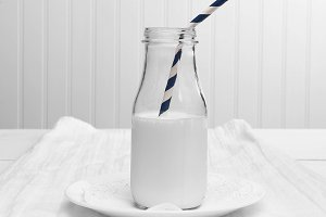 Milk bottle with drinking straw