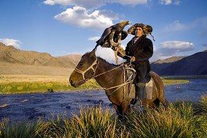 Mongolian man on a horse