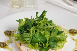 Slices roasted chicken with lettuce