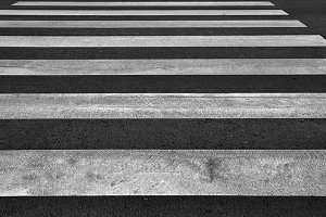 Zebra pedestrian crossing as urban background image.