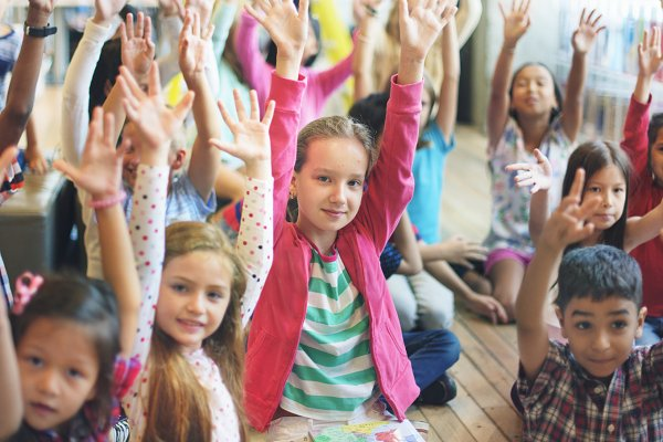 kids hands up Diversity classroom