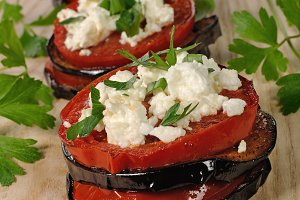 Roasted eggplant with tomatoes and r