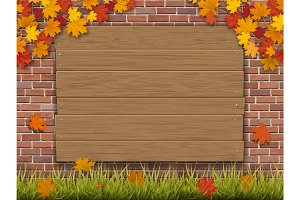 wooden sign on brick wall autumn maple branches