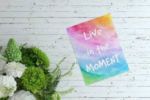 Live in the moment. Decorative card.