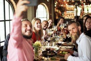 Friends having dinner party