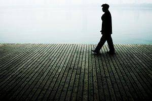 Chinese man walking on the boardwalk
