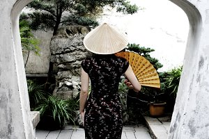 A Chinese woman in a garden