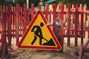 little boy on the repaired road