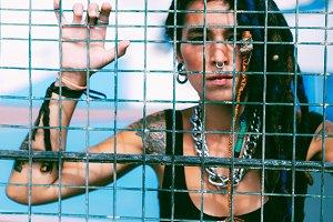 Girl behind the metal grid