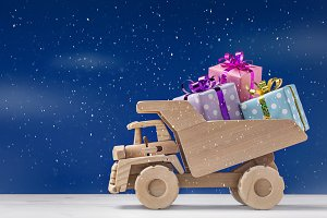 Delivery of gifts on toy truck.