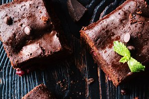 Dark chocolate brownies on dark background