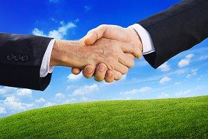 Business handshaking dealing