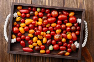 Tray with colorful cherry tomatoes