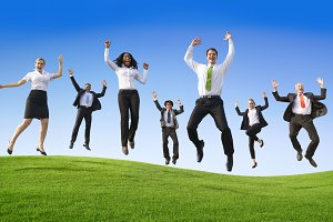 Business workers jumping