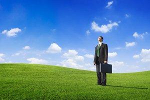 Businessman Standing on Hills