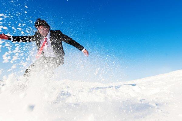 Businessman snow boarding