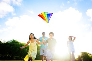 Family playing with a kite outdoors