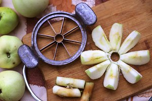 apple knife cutter with cut slices core and whole apples