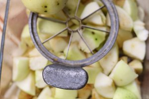 apple knife cutter with cut slices core and whole apples close up photo