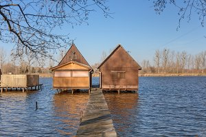 Wooden house on the lake at winter