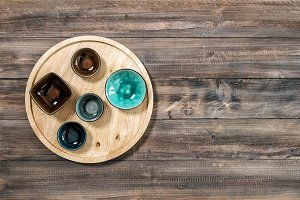 Colorful plates wooden background