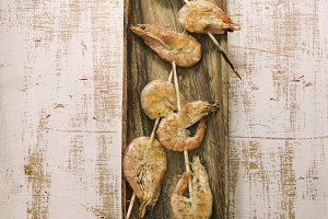 two skewers of shrimp, grilled with
