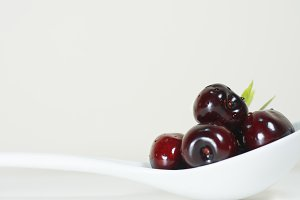 Cherries on white background natural