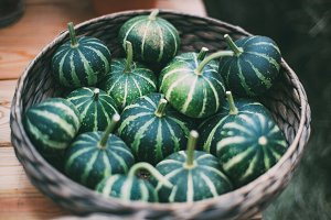 Decorative pumpkins in basket