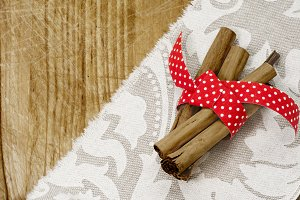 Cinnamon sticks, wrapped in red ribb