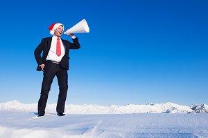 Christmas businessman with megaphone