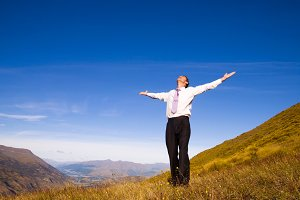 Businessman standing on the mountain