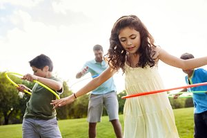 Family playing Hula Hoop