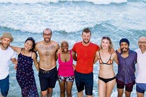 Diverse friends gather near beach