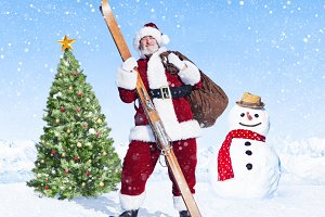 Santa claus holding sack and skis