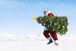 Santa claus carrying christmas tree