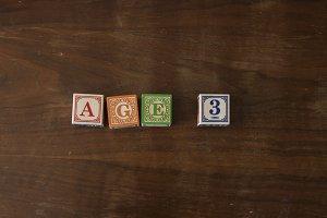 Age 3 in wooden blocks